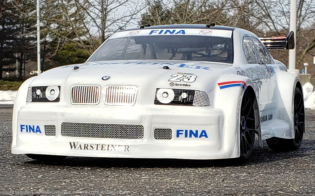 URCG Edition - Traxxas Slash 4x4, Delta Plastik USA body - White BMW M3, Sweep Racing Tires - named Big Pearls (side view)