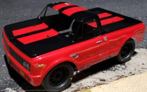 URCG Edition - Traxxas Slash 4x4, JConcepts body - Red Chevy 72 C-10, ProLine Prime Tires - named Big Red (side view)