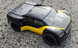 URCG Edition - Traxxas Slash 4x4, JConcepts body - Black Illuzion, ProLine Prime Tires - named Yello' Jack (top view)