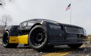 URCG Edition - Traxxas Slash 4x4, JConcepts body - Black Illuzion, ProLine Prime Tires - named Yello' Jack (front view)