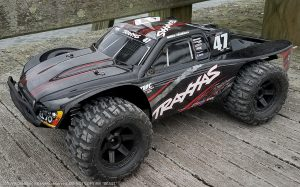 URCG Edition - Traxxas Slash 4x4 TSM OBA - Mike Jenkins, ProLine Trencher Tires - named Beast (side view)