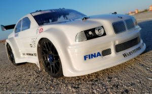 URCG Edition - Traxxas Slash 4x4, Delta Plastik USA body - White BMW M3, Sweep Racing Tires - named Big Pearls (front view)