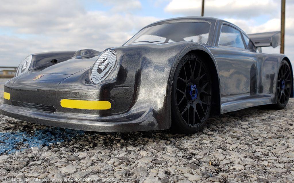 URCG Edition - Traxxas Slash 4x4, Delta Plastik USA body - Gunmetal Porsche 911 GT3, Sweep Racing Tires - named Brock (front view)
