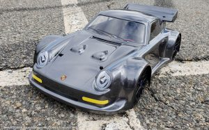 URCG Edition - Traxxas Slash 4x4, Delta Plastik USA body - Gunmetal Porsche 911 GT3, Sweep Racing Tires - named Brock (front view)