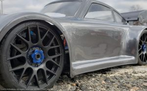 URCG Edition - Traxxas Slash 4x4, Delta Plastik USA body - Gunmetal Porsche 911 GT3, Sweep Racing Tires - named Brock (side view)