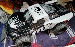 URCG Edition - Traxxas Slash 4x4 TSM OBA - FOX, ProLine Trencher Tires - named Foxy (top-view)