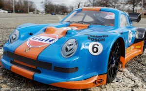 URCG Edition - Traxxas Slash 4x4, Delta Plastik USA body - Blue Porsche 911 GT3, Sweep Racing Tires - named Gulfie (front view)