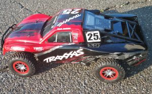 URCG Edition - Traxxas Slash 4x4 TSM OBA - Mark Jenkins, ProLine Trencher Tires - named Larry The Lawnmower (side view)