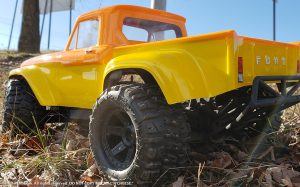URCG Edition - Traxxas Slash 4x4, ProLine body - Yellow Ford 66 F-100, ProLine Trencher Tires - named Mac 'n' Cheese (rear view)