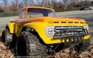 URCG Edition - Traxxas Slash 4x4, ProLine body - Yellow Ford 66 F-100, ProLine Trencher Tires - named Mac 'n' Cheese (front view)