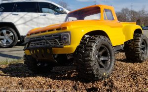 URCG Edition - Traxxas Slash 4x4, ProLine body - Yellow Ford 66 F-100, ProLine Trencher Tires - named Mac 'n' Cheese (side view)