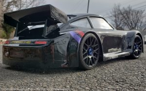 URCG Edition - Traxxas Slash 4x4, Delta Plastik USA body - Black Porsche 911 GT3, Sweep Racing Tires - named Midnight Madness (side view)