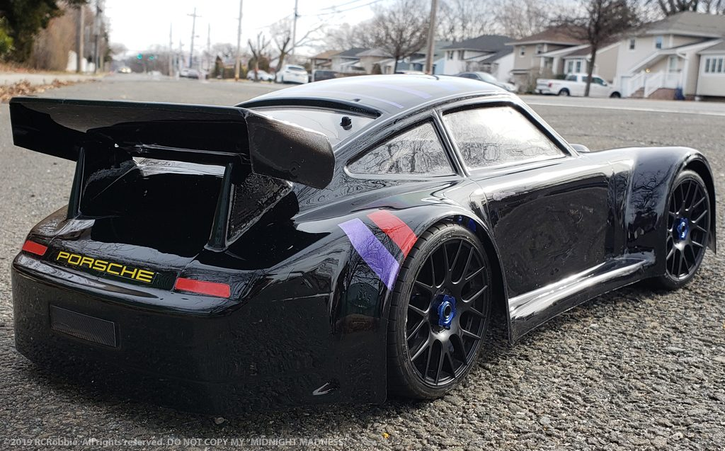 URCG Edition - Traxxas Slash 4x4, Delta Plastik USA body - Black Porsche 911 GT3, Sweep Racing Tires - named Midnight Madness (rear view)