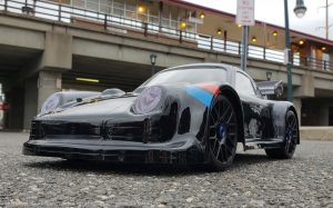 URCG Edition - Traxxas Slash 4x4, Delta Plastik USA body - Black Porsche 911 GT3, Sweep Racing Tires - named Midnight Madness (front view)