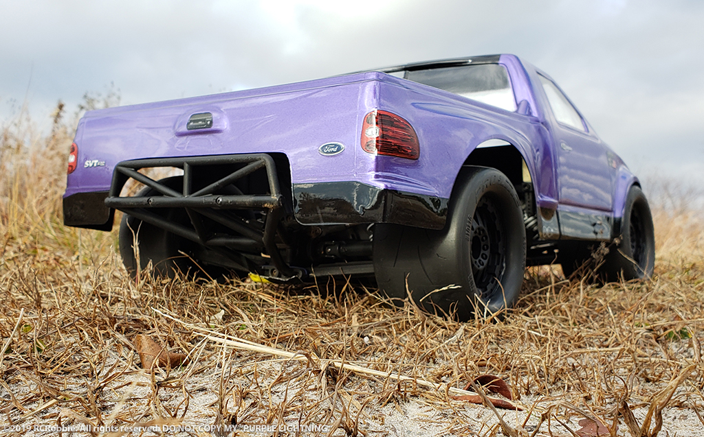 URCG Edition - Traxxas Slash 4x4, JConcepts body - Purple Ford 99 Lightning, ProLine Prime Tires - named Purple Lightning (rear view)