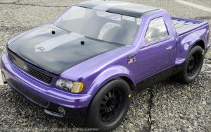 URCG Edition - Traxxas Slash 4x4, JConcepts body - Purple Ford 99 Lightning, ProLine Prime Tires - named Purple Lightning (front view)