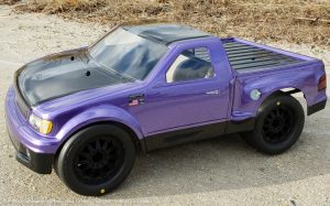 URCG Edition - Traxxas Slash 4x4, JConcepts body - Purple Ford 99 Lightning, ProLine Prime Tires - named Purple Lightning (side view)