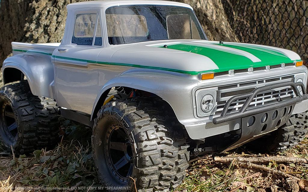 URCG Edition - Traxxas Slash 4x4, ProLine body - White Ford 66 F-100, ProLine Trencher Tires - named Spearmint (front view)
