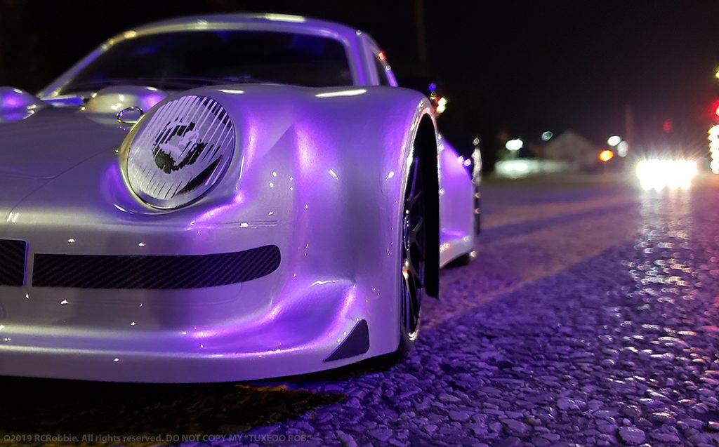 URCG Edition - Traxxas Slash 4x4, Delta Plastik USA body - Silver Porsche 911 GT3, Sweep Racing Tires - named Tuxedo Rob (front view)