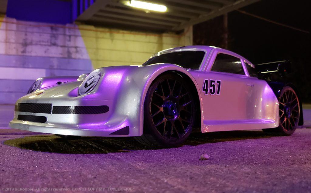URCG Edition - Traxxas Slash 4x4, Delta Plastik USA body - Silver Porsche 911 GT3, Sweep Racing Tires - named Tuxedo Rob (side view)