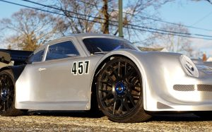 URCG Edition - Traxxas Slash 4x4, Delta Plastik USA body - Silver Porsche 911 GT3, Sweep Racing Tires - named Tuxedo Rob (side view)