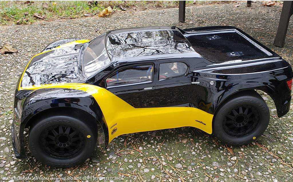 URCG Edition - Traxxas Slash 4x4, JConcepts body - Black Illuzion, ProLine Prime Tires - named Yello' Jack (side view)
