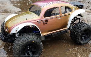 URCG Edition - Traxxas Slash 4x4, Pro-Line body - Iridescent Pink/Gold, Anodized Pink Aluminum Roof, and white fendered Volkswagen Beetle, Proline Trencher Tires - named Buggin' Beetle